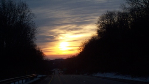 More of the sunset.  You have no idea how many shots I took to get these as I was doing them one handed, driving at speed, in traffic and over potholes.