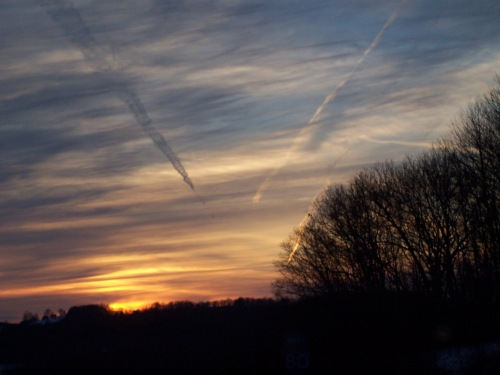 Plane trails and the sunset on my way home.