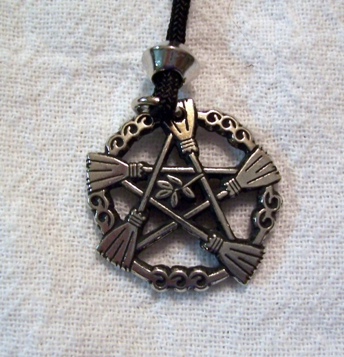 The Broom Pentacle (Brooms of Elder).  I have looked at this necklace a couple of years in a row.  This year I bought it.  I am going to change the cord to a chain at some point.